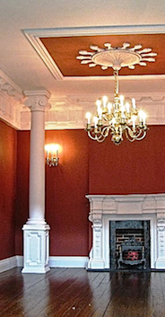 A striking red room designed by Emma waddell with C12 coving, Columns CM4, pedestals CP6, fireplace PF9 and BBGE3 grate